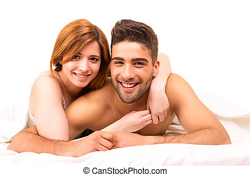 Couple - A beautiful young passionate couple in bed