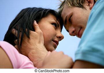 Couple about to kiss, low-angle shot
