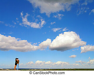 couple against blue sky