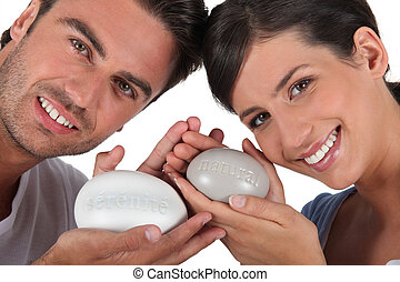 couple all smiles with bar of soap