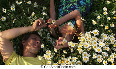 Couple among daisies