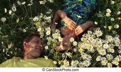 Couple among flowers