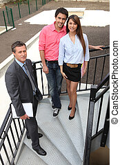 couple and a real estate agent