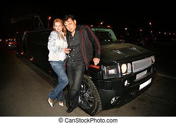 couple and big car
