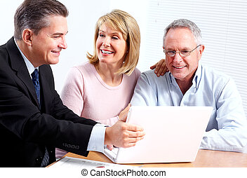 Couple and consultant. - Senior couple with financial...