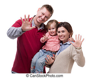 couple and their little daughter with palms up
