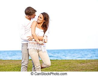 couple, apprécier, plage, jeune, eux-mêmes