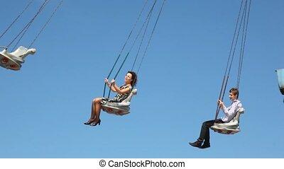 Couple are on merry-go-round.