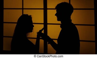 Couple arguing at home. Silhouette. Close up