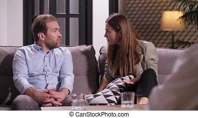 Couple arguing at psychologist - Close-up of arguing husband...