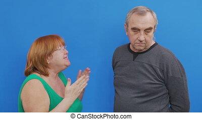 Couple arguing- elderly couple quarrels accusing each other