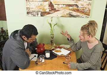 couple arguing at table