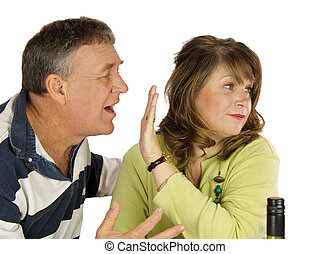 Couple Arguing - Unhappy middle aged couple arguing over ...