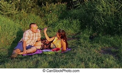 Couple At A Picnic Eating Watermelon
