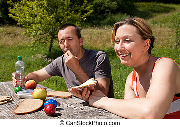 Couple at a picnic in nature