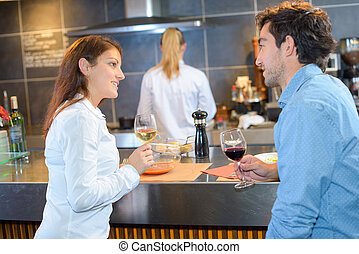 Couple at bar of restaurant