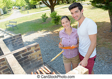 Couple at barbeque