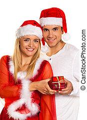 Couple at Christmas with Santa Claus hats