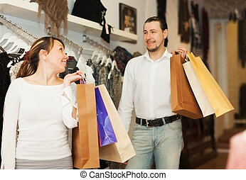 Couple at clothing store