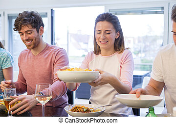 Couple At Dinner Party - Shot of a couple at a dinner party....