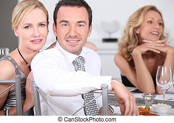 couple at dinner party with friends