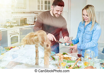 Couple at Family Dinner