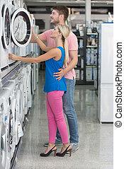 Couple At Groceries Store Buy Washing Machine - Beautiful...