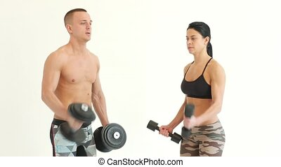 Couple at Gym Doing Exercises