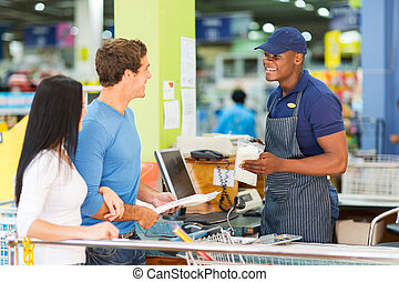 couple at hardware store till point - couple paying at...