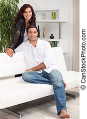 Couple at home in front room