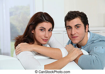 Couple at home watching television