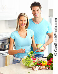 Couple at kitchen - Young love couple cooking at kitchen