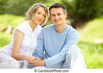 Couple at leisure - Portrait of young amorous couple looking...