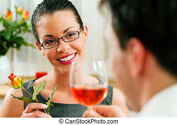Couple at lunch or dinner - Young couple having romantic...