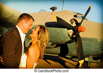 couple at old Albatross aircraft
