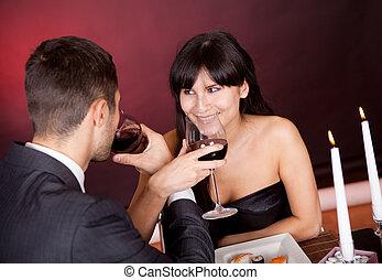 Couple at romantic dinner in restaurant