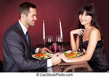 Couple at romantic dinner in restaurant - Lovely young...