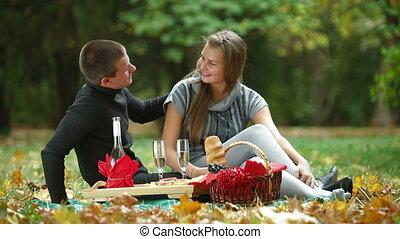 Couple at romantic picnic in autumn