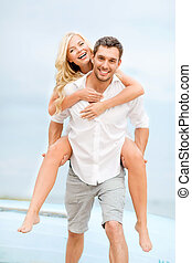 couple at seaside - summer holidays, celebration and dating...