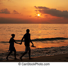 Couple at sunset - Couple walking on the beach at sunset...