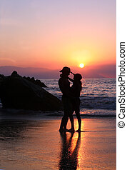Couple at sunset - Couple on the beach at sunset