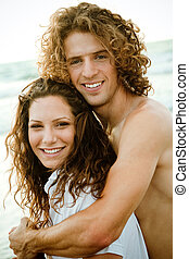 Couple at the beach embracing