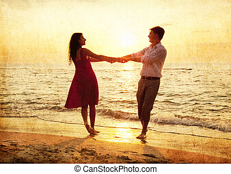 Couple at the beach in sunset.