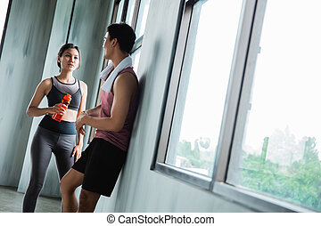 couple at the gym chating in the break time