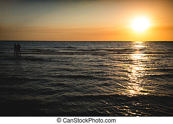 couple at the sunset beach