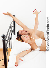couple awaking together in bed