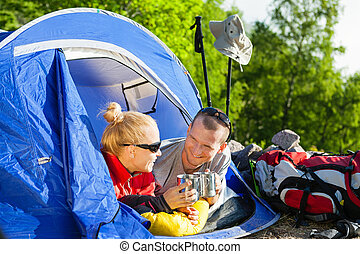 Couple backpackers camping in tent - Man and woman hikers ...