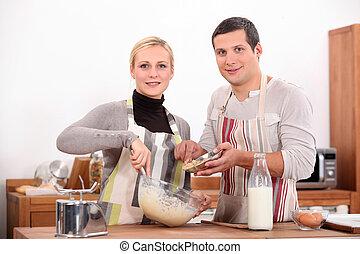 Couple baking in kitchen
