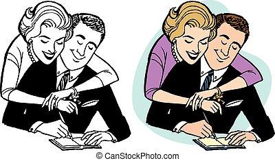 Couple Balancing Checkbook - A couple balances their...