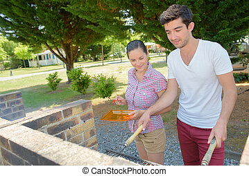 Couple barbequeing